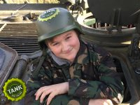 Teenager at the helm of a tank
